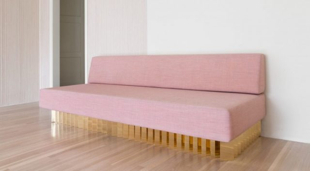 Pink and brass sofa