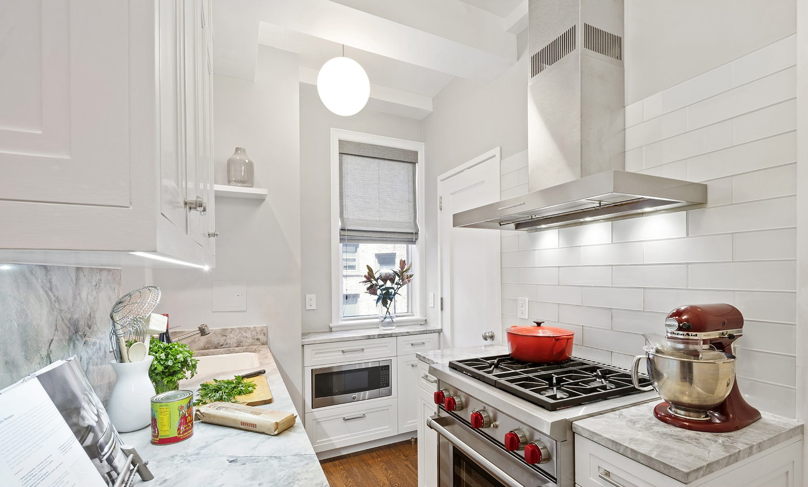 Gray and White kitchen with marble quartzite countertop and stainless appliances