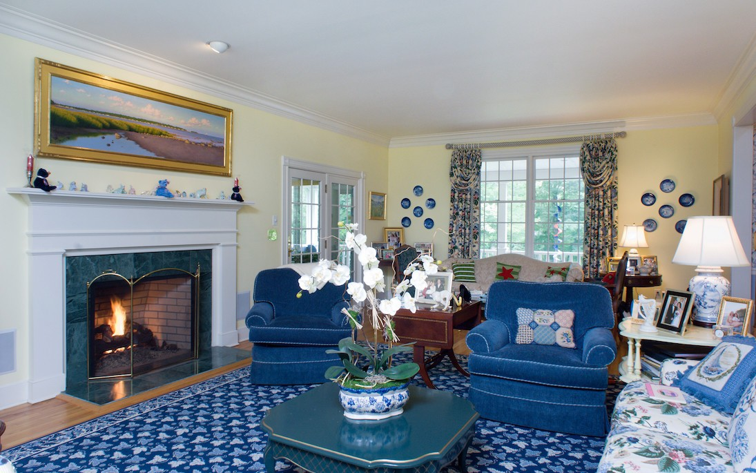 living room makeover with black steel fireplace in Greenwich CT