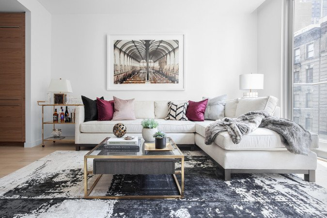 feminine black white sofa magenta accents