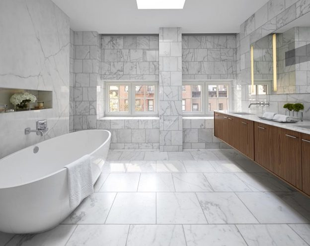 white carrara marble spacious bathroom