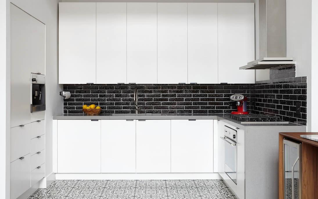 sleek kitchen white cabinets
