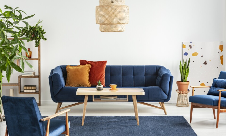Blue wooden armchairs and couch in living room