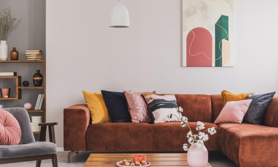Cozy, brown corner sofa with decorative cushions