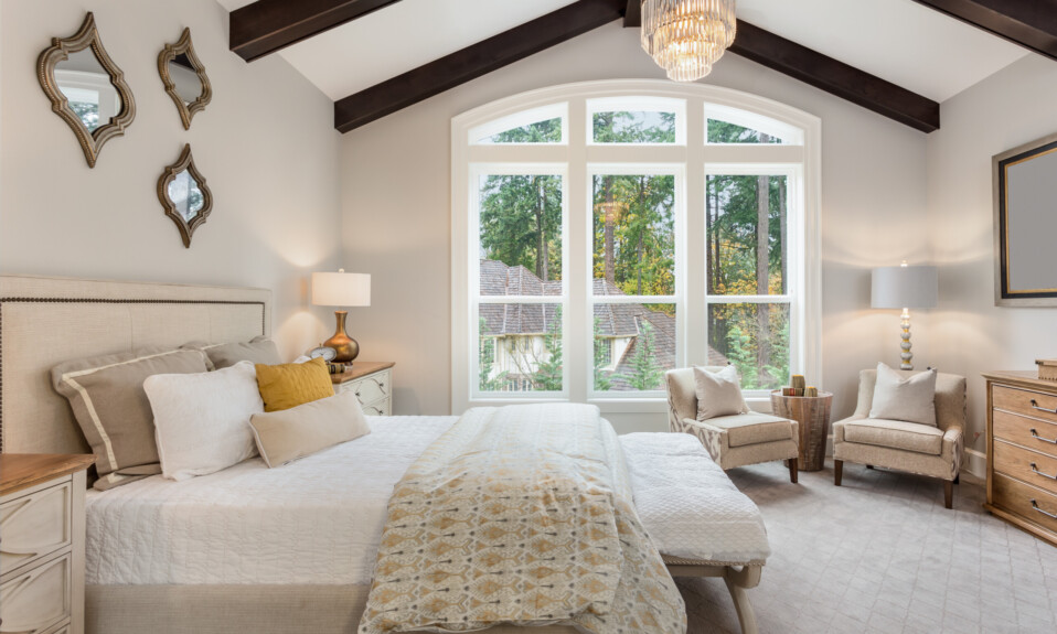 bedroom with wooden beams vaulted ceiling