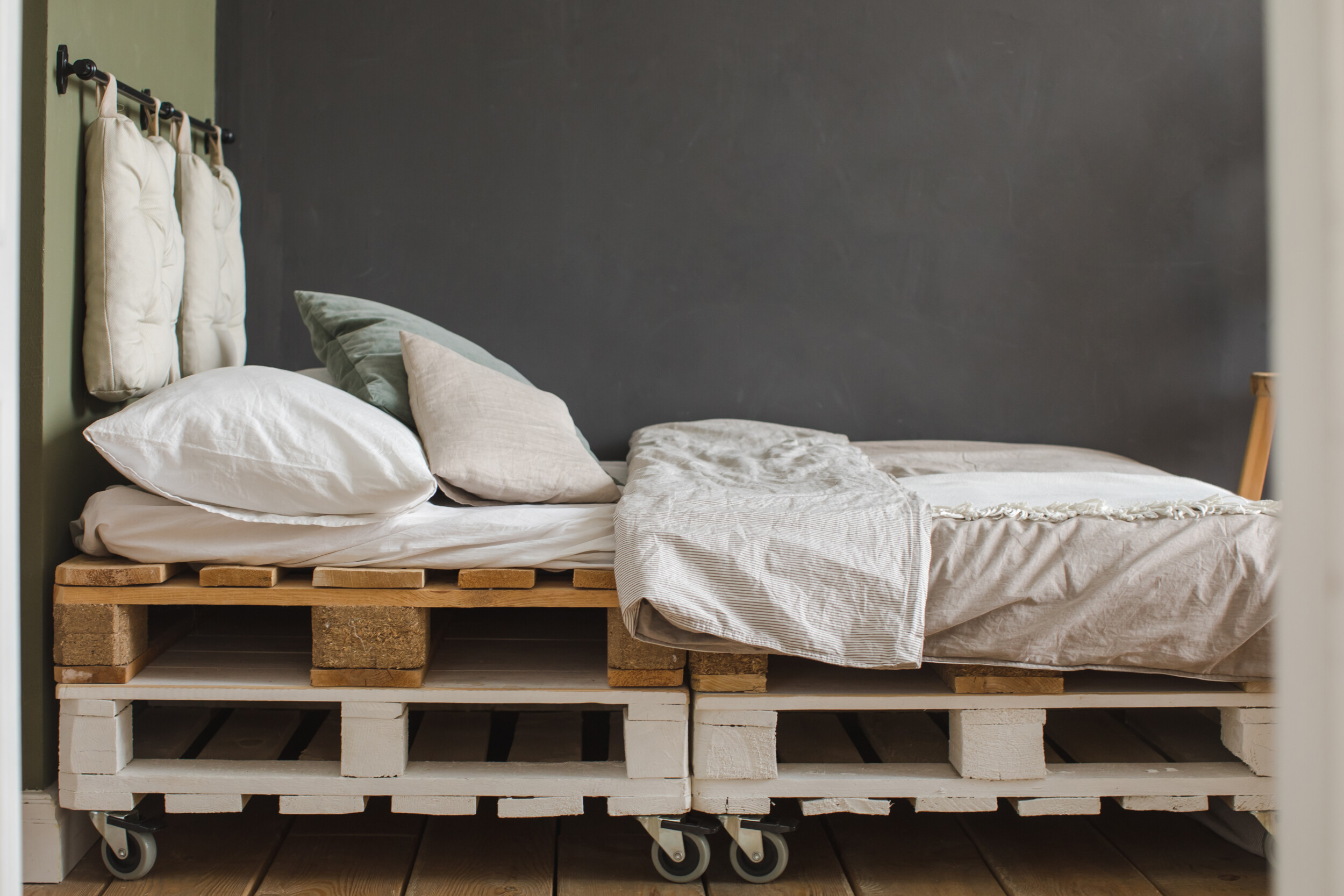 industrial style bedroom with recycled pallet bed
