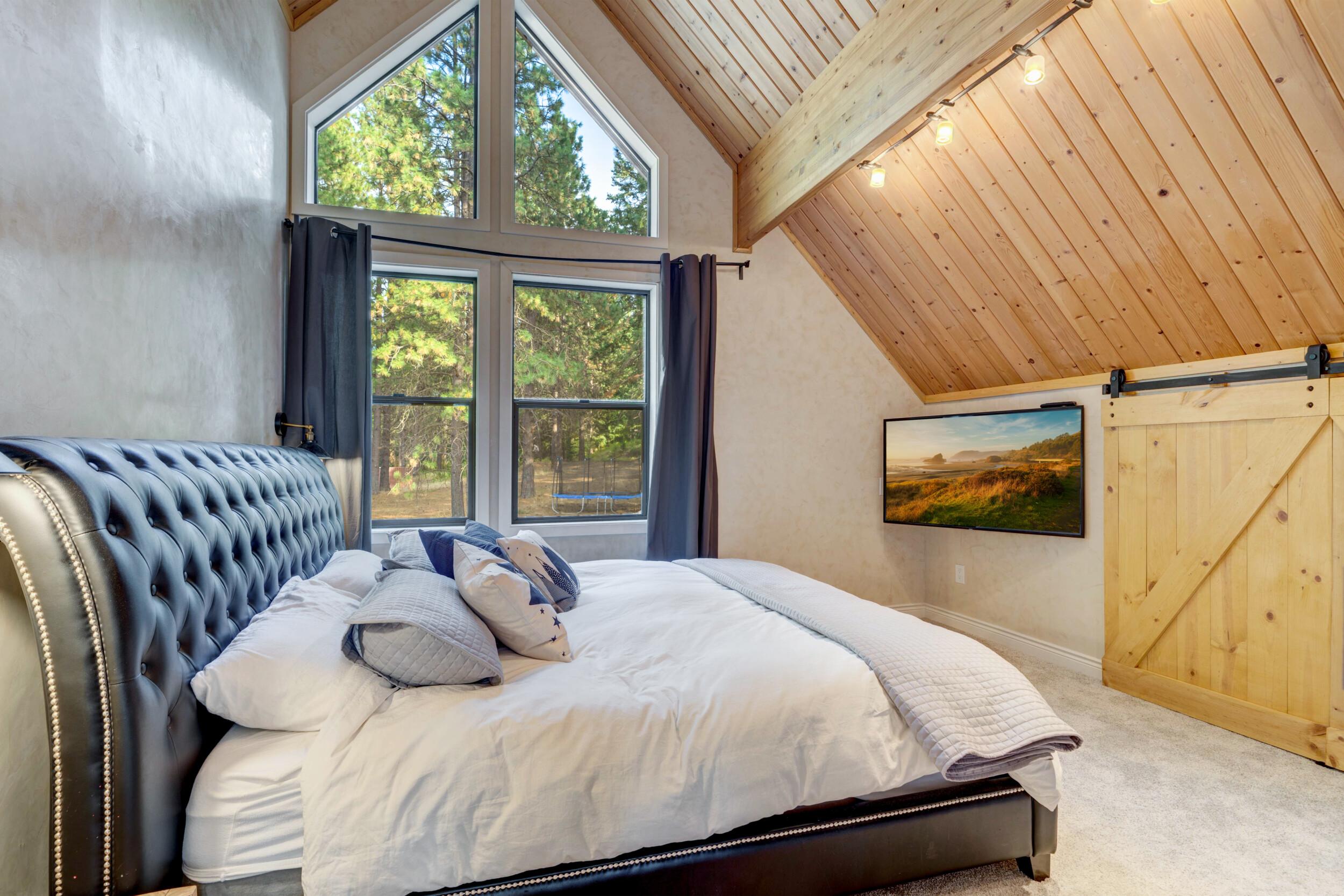 modern vaulted ceiling bedroom