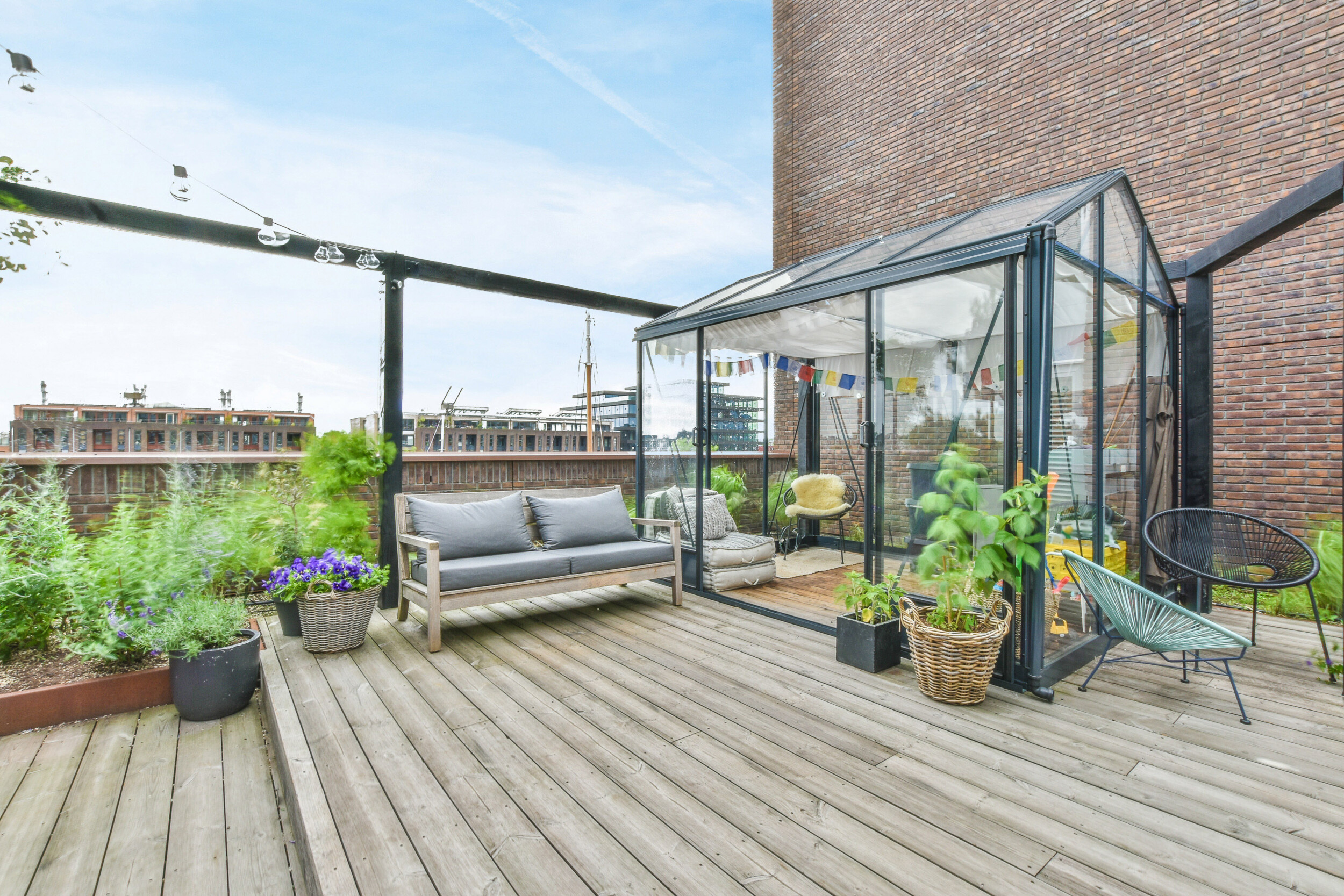 outdoor deck with greenhouse