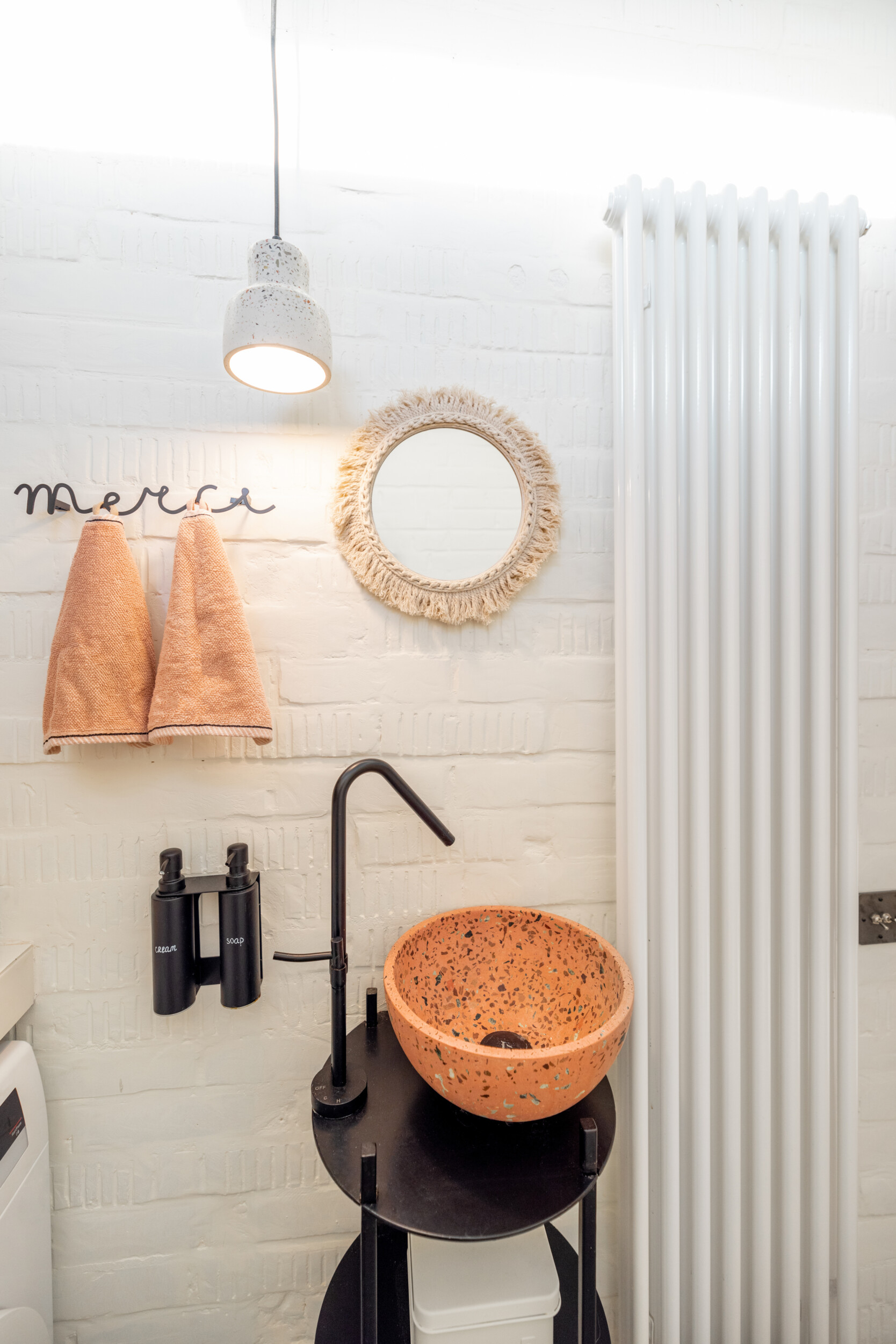 toilet interior with terrazo sink