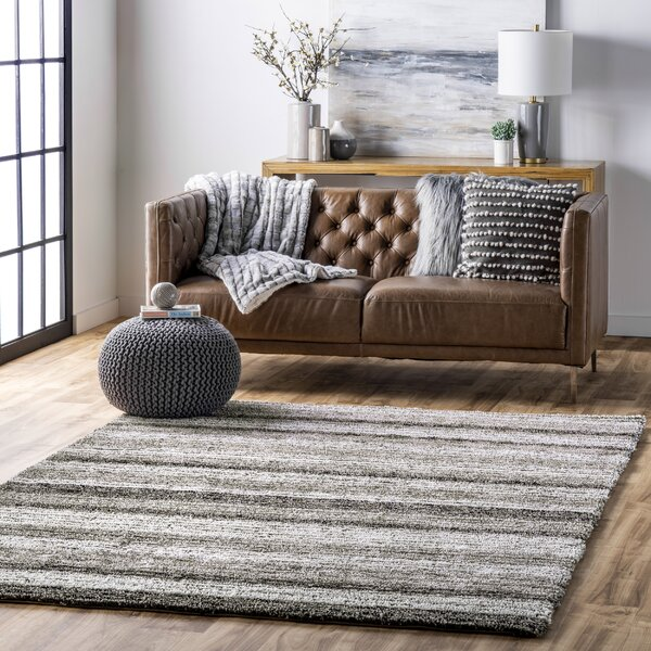 grey and white striped tufted rug